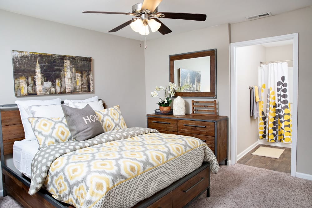 A bedroom with plush carpeting and a ceiling fan at 7029 West in Greensboro, North Carolina