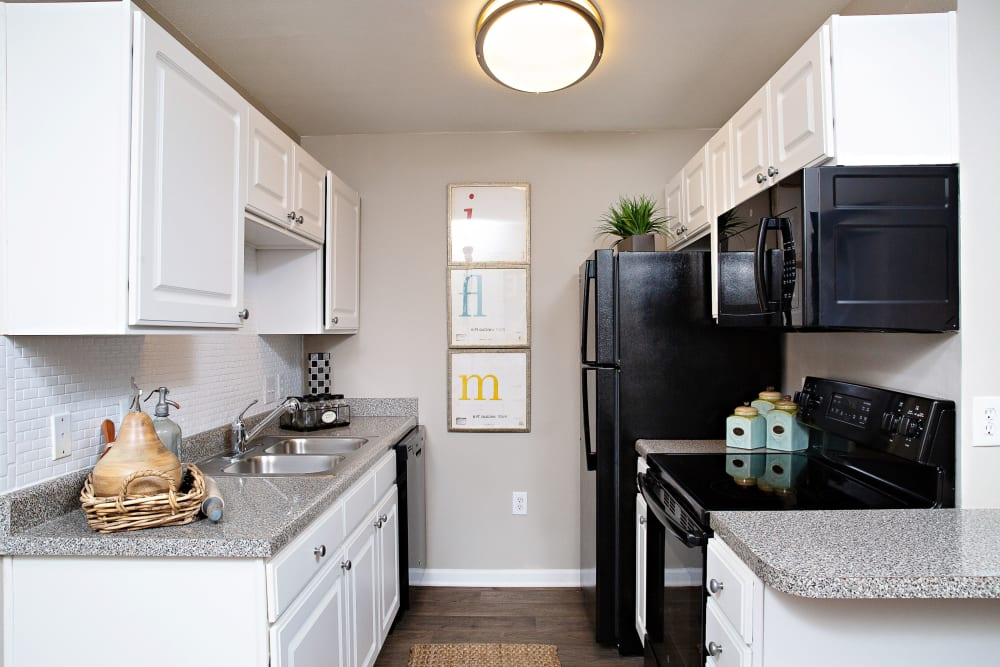 A kitchen with white cabinets at 7029 West in Greensboro, North Carolina
