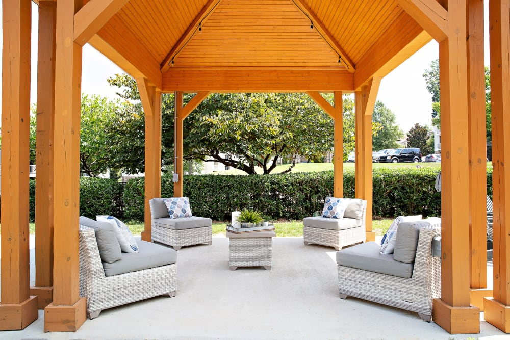 A covered outdoor lounge at 7029 West in Greensboro, North Carolina