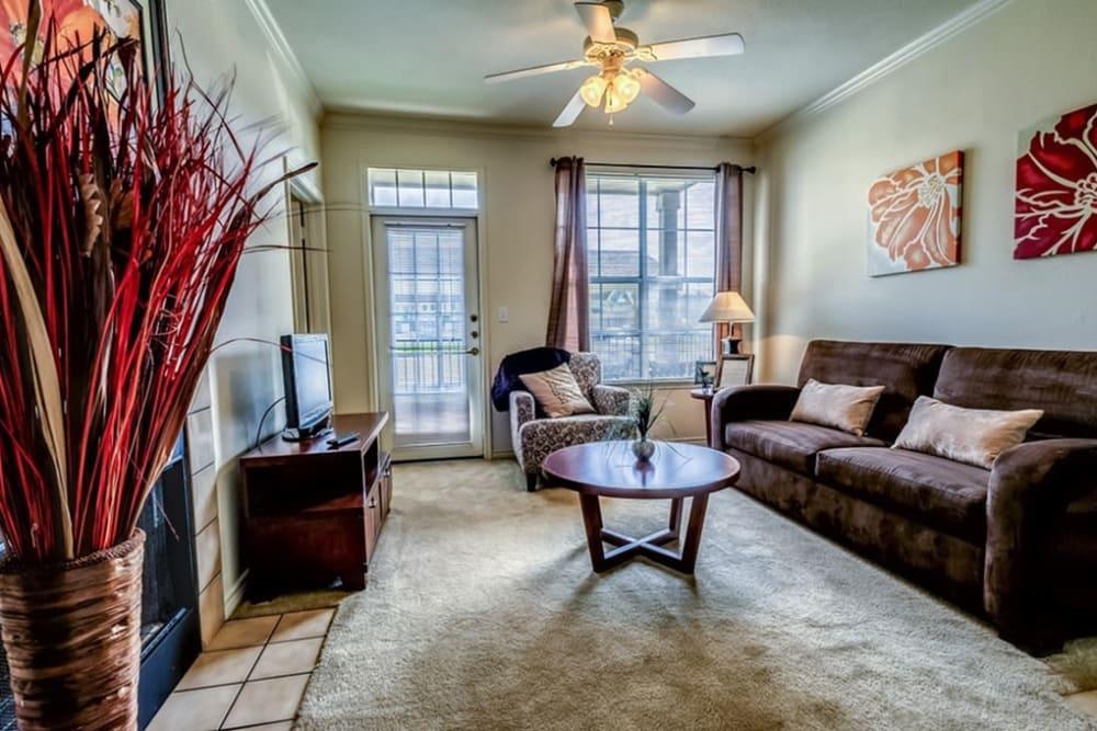 Model living room at Audubon Lake Apartment Homes in Lafayette, Louisiana