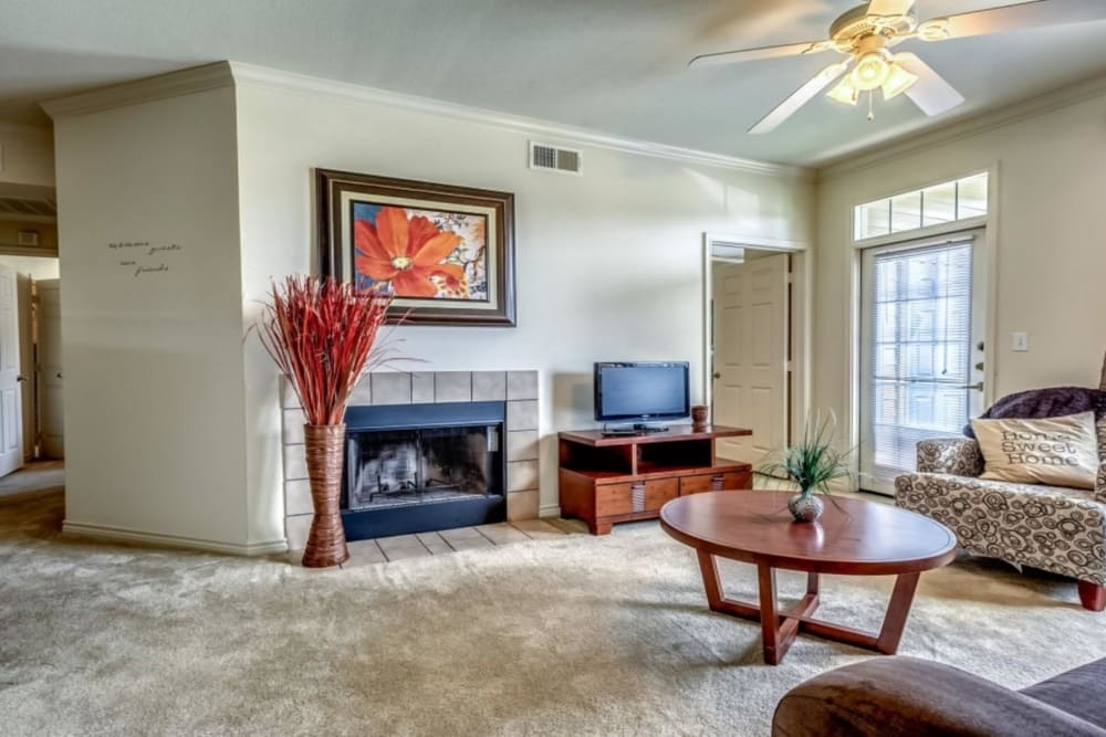 Fireplace in model home at Audubon Lake Apartment Homes in Lafayette, Louisiana