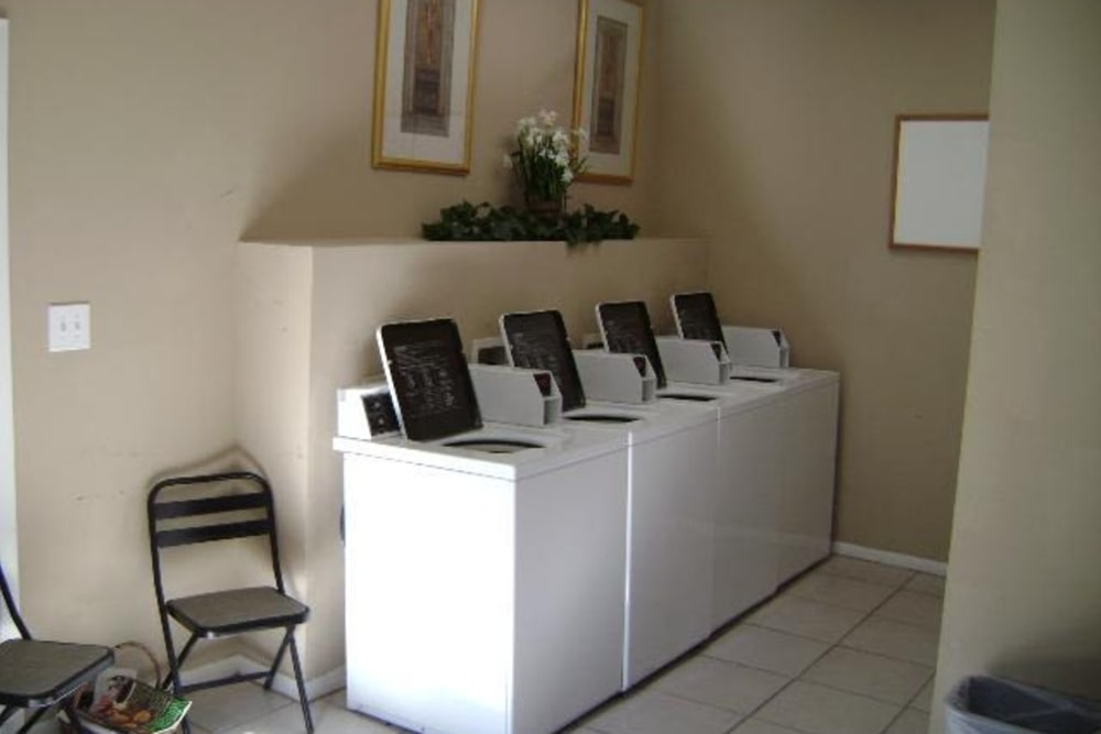Laundry room at Grand Seasons Apartment Homes in Dallas, Texas