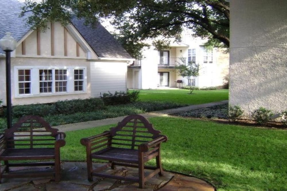 Outdoor patio by pool at Grand Seasons Apartment Homes in Dallas, Texas
