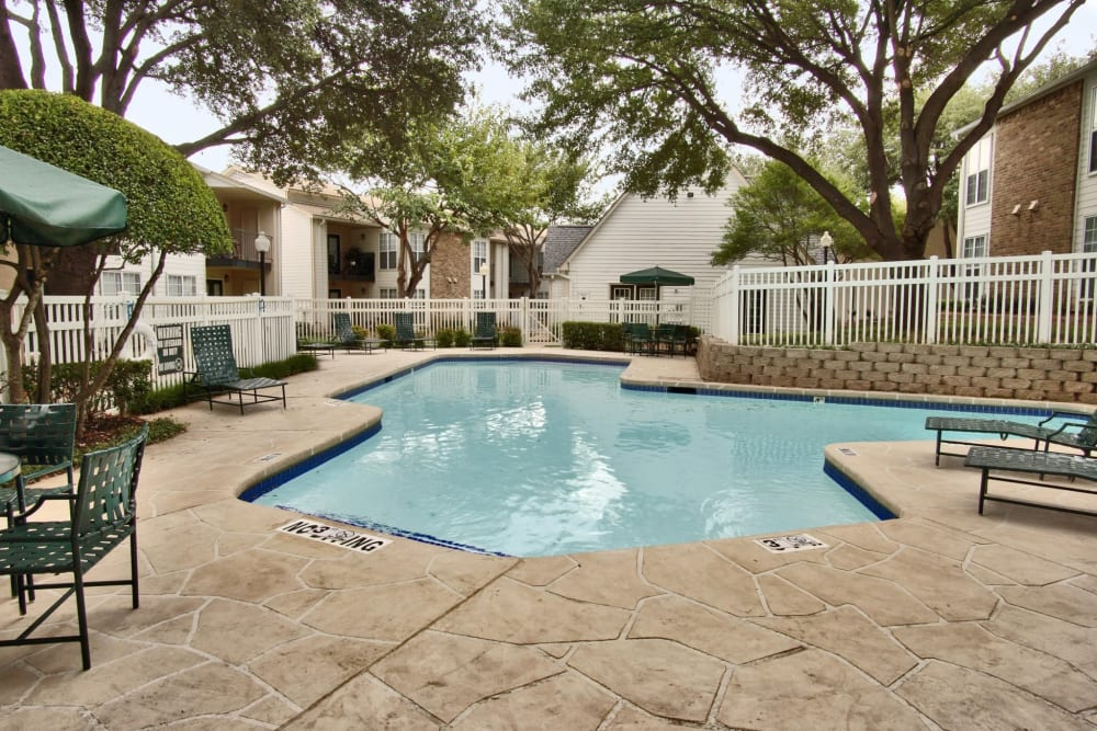 Sparkling pool at Grand Seasons Apartment Homes in Dallas, Texas
