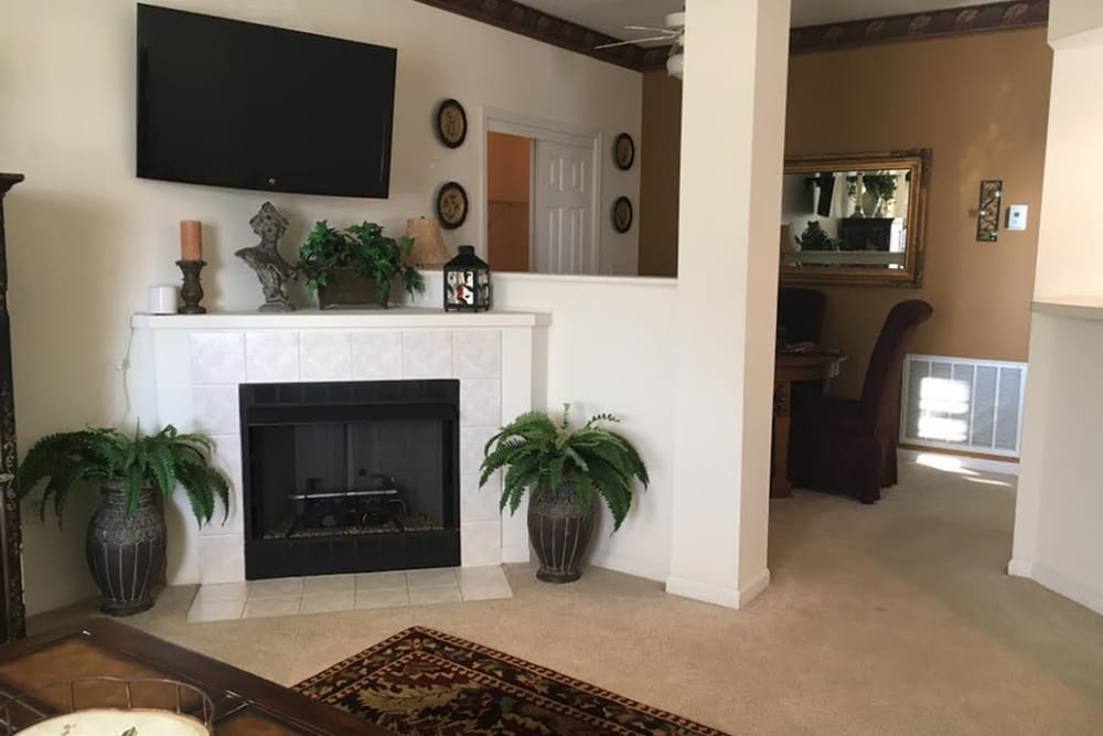 Fireplace in home at Lake Pointe Apartment Homes in Portage, Indiana