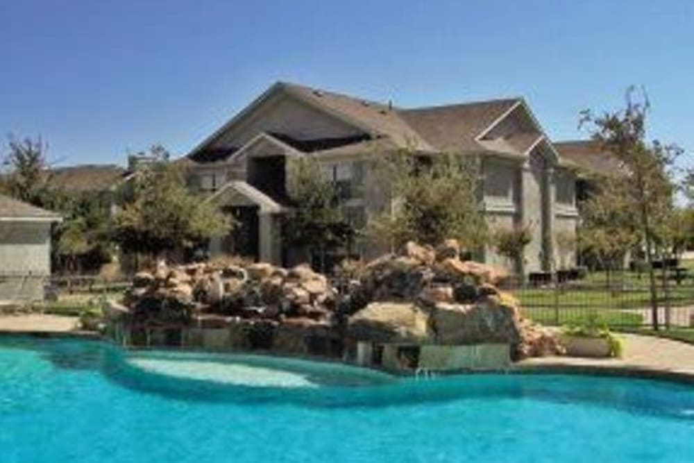 Sparkling pool at Legacy of Cedar Hill Apartments & Townhomes in Cedar Hill, Texas