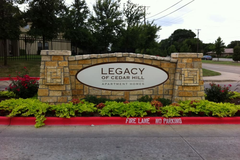 Front sign at Legacy of Cedar Hill Apartments & Townhomes in Cedar Hill, Texas