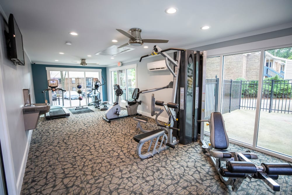 A fitness center with individual workout stations at Mill Creek Flats in Winston Salem, North Carolina