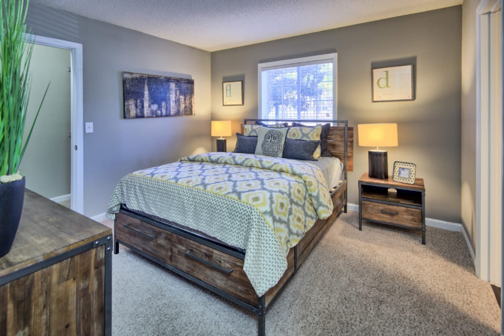 A bedroom with plush carpeting at Residences at West Mint in Mint Hill, North Carolina