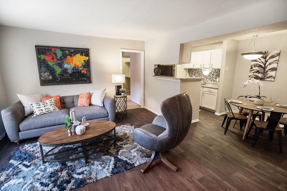 A spacious living room with wood-style flooring at The Corners at Crystal Lake in Winston Salem, North Carolina