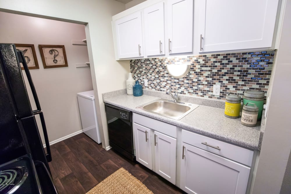A kitchen with plenty of cabinetry at The Corners at Crystal Lake in Winston Salem, North Carolina