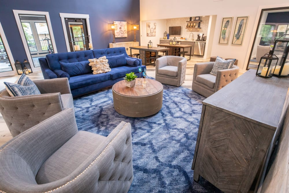 A clubhouse with plenty of comfortable seating at The Corners at Crystal Lake in Winston Salem, North Carolina
