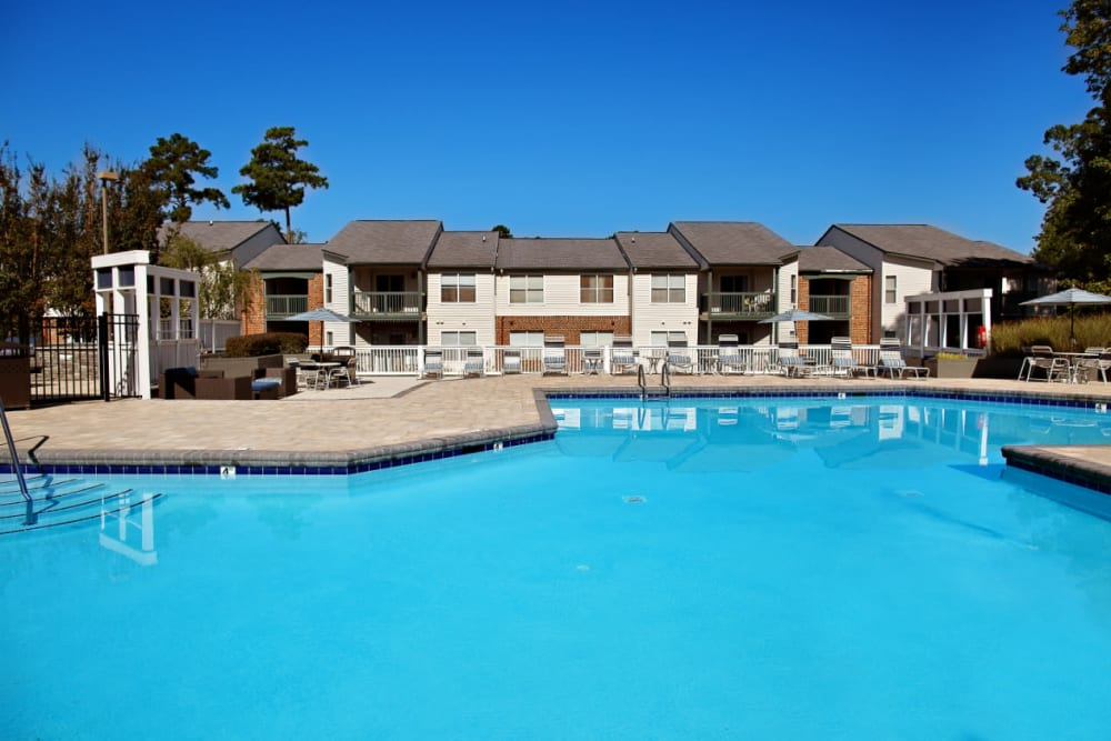 A swimming pool with a large sundeck at Woodlake Reserve in Durham, North Carolina