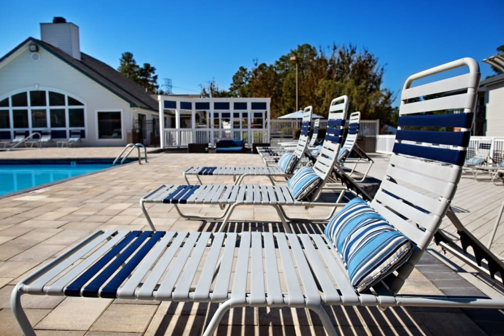 Poolside lounge chairs at Woodlake Reserve in Durham, North Carolina