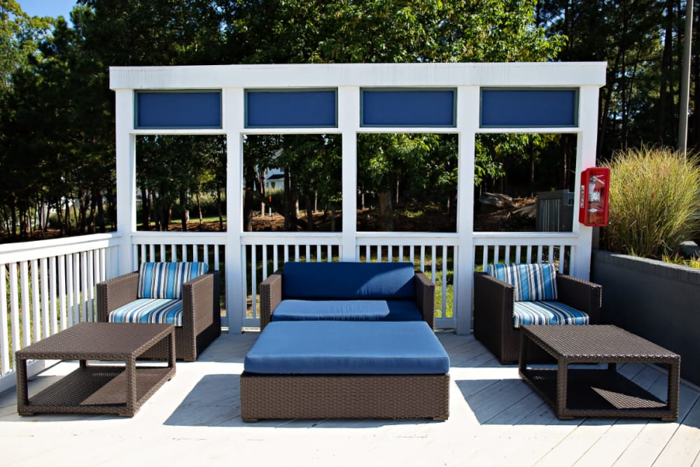 An outdoor lounge area next to the barbeques at Woodlake Reserve in Durham, North Carolina