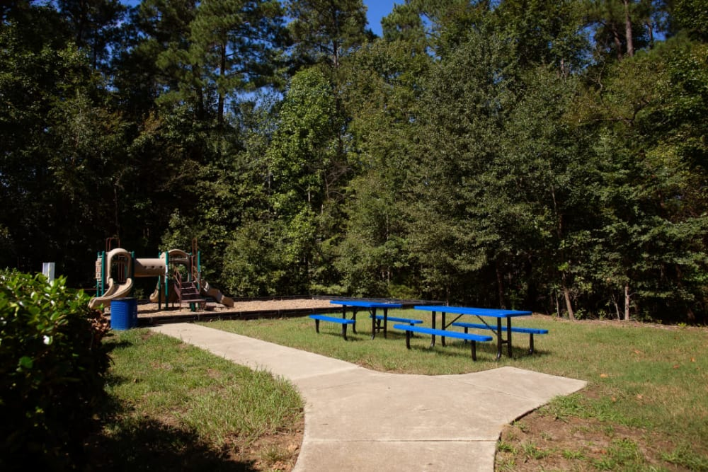 A grassy picnic area next to the playground at Woodlake Reserve in Durham, North Carolina