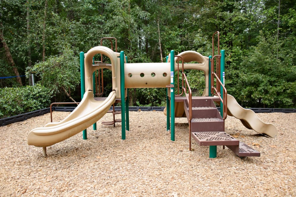 A children's park with a slide at Woodlake Reserve in Durham, North Carolina