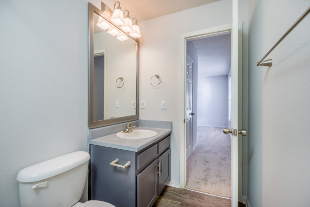 A bathroom with a large vanity mirror at The Harlowe in Charlotte, North Carolina