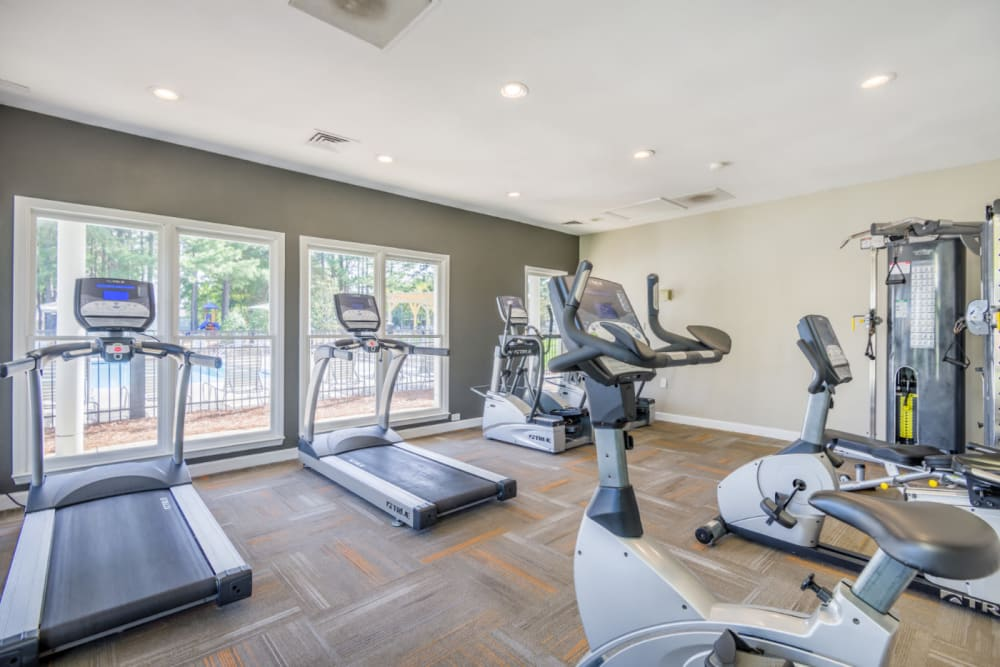 A fitness center with individual workout stations at The Harlowe in Charlotte, North Carolina