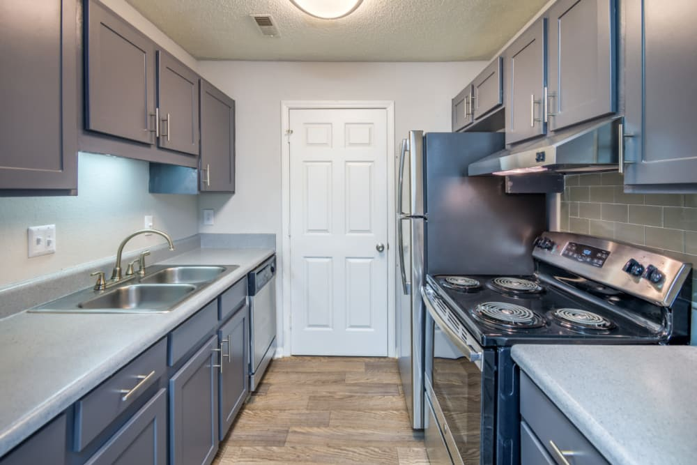 A kitchen with plenty of countertop space at The Harlowe in Charlotte, North Carolina