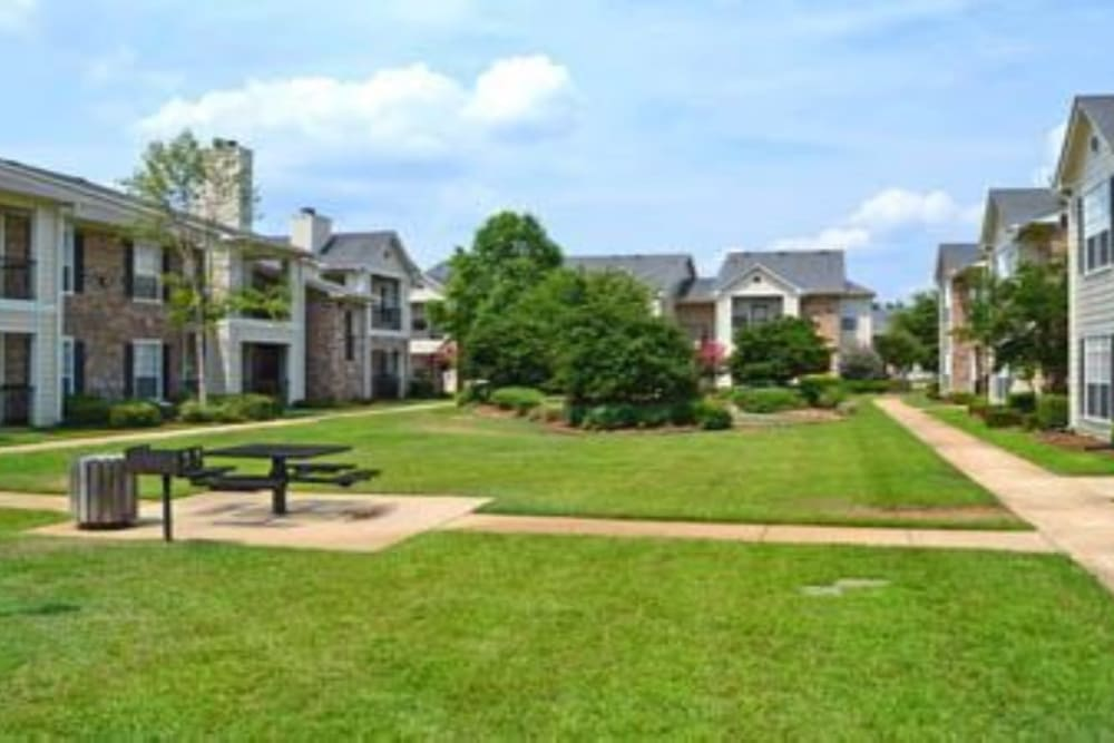 Beautiful green lawns at River Walk Apartment Homes in Shreveport, Louisiana
