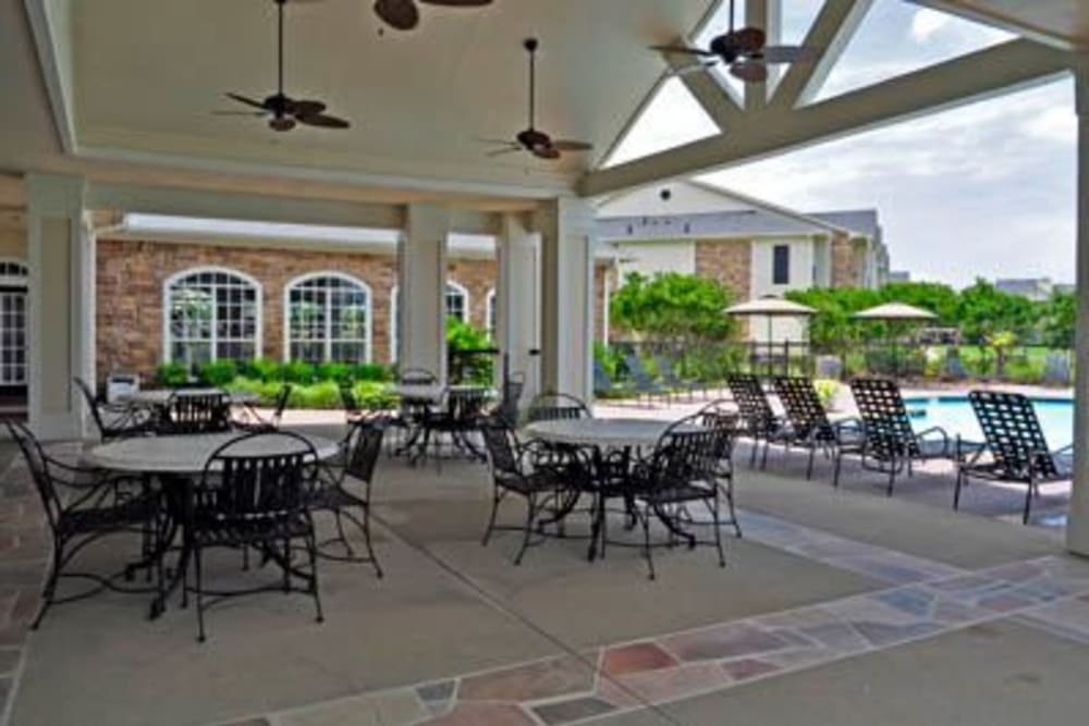 Covered pool patio at River Walk Apartment Homes in Shreveport, Louisiana