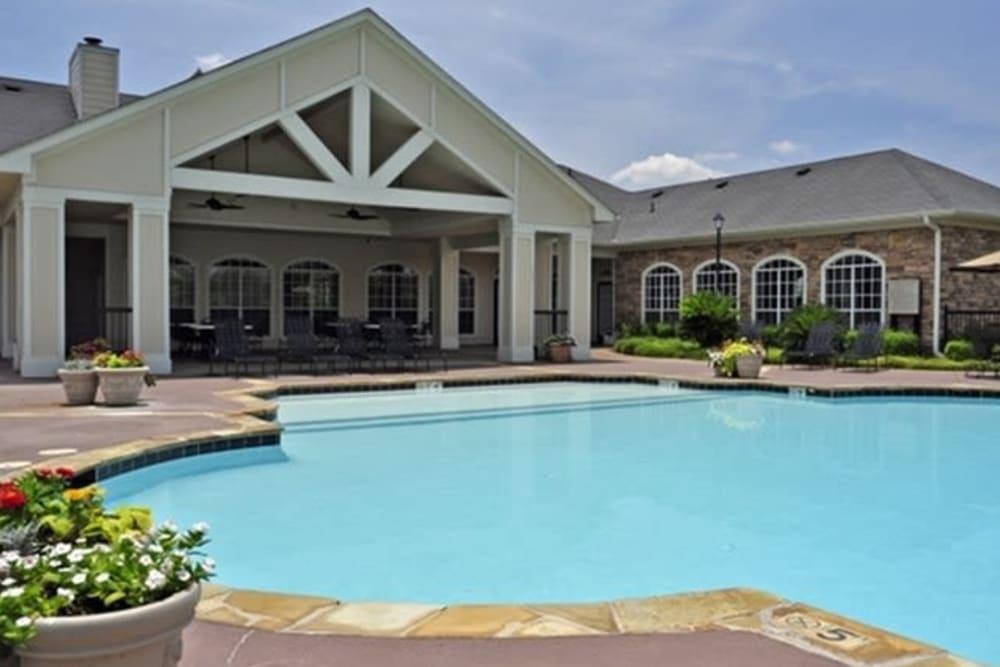 Sparkling pool at River Walk Apartment Homes in Shreveport, Louisiana