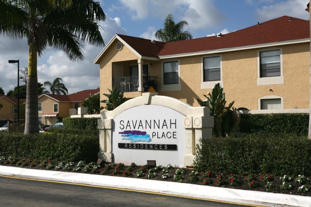 Front sign at Savannah Place Apartments & Townhomes in Boca Raton, Florida
