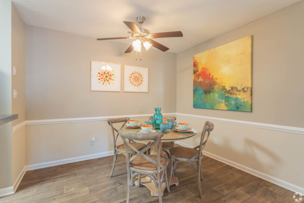 A spacious dining room with a ceiling fan at The Samuel in Hampton, Virginia