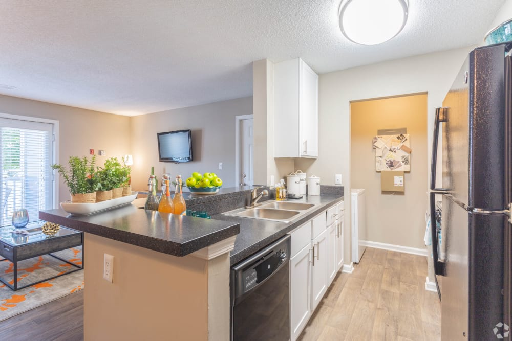 A kitchen with a breakfast bar at The Samuel in Hampton, Virginia