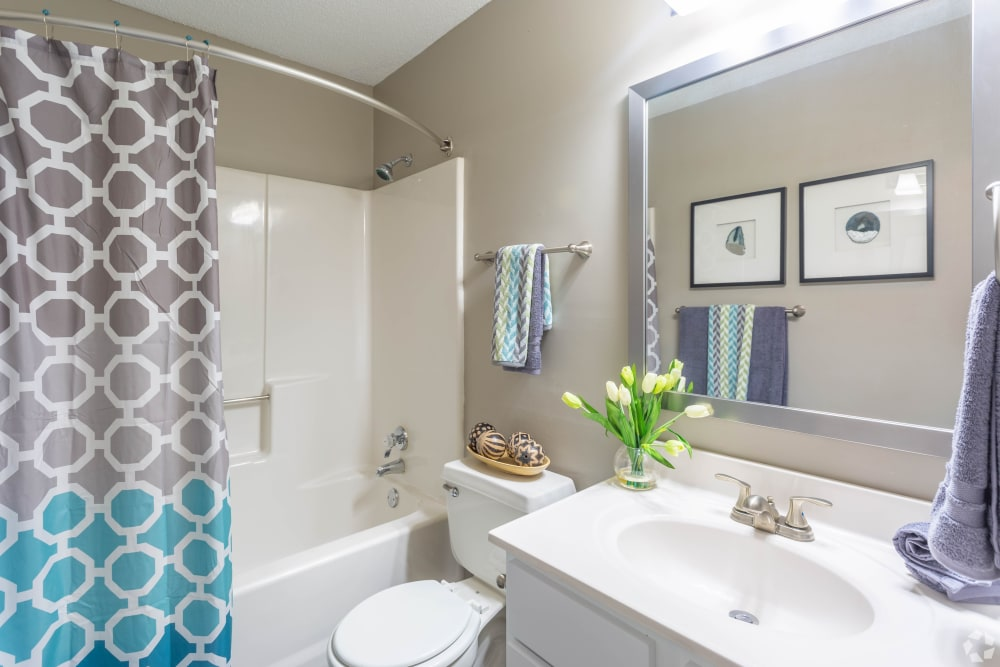 A  bathroom with an oval tub at The Samuel in Hampton, Virginia