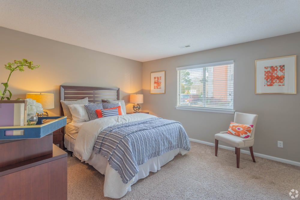 A large bedroom with plush carpeting at The Samuel in Hampton, Virginia
