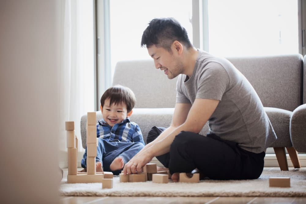 Resident playing blocks with his young son at Carvel Harbour Pointe in Mukilteo, Washington