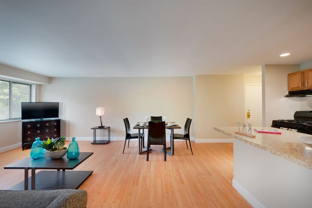 A large open living room with wood-style flooring at The Landings I & II Apartments in Alexandria, Virginia