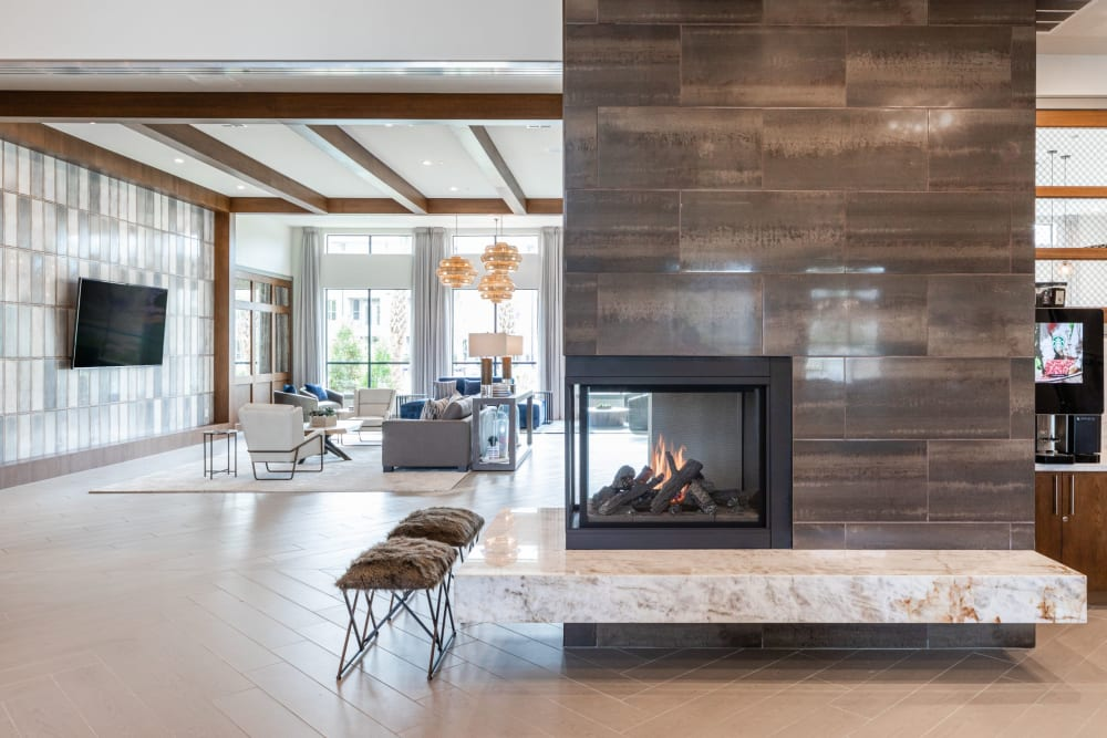 Fireplace and striking architecture in the lobby of American Landmark's Opal at Barker Cypress luxury property