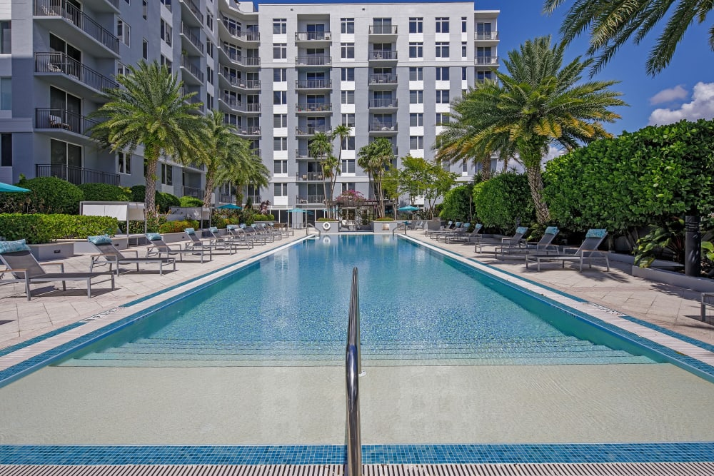 Beach-style entry swimming pool at American Landmark's Midtown 24 luxury community