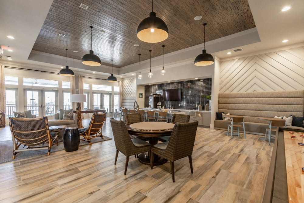 Modern decor and new hardwood flooring in the clubhouse lounge at American Landmark's Parc at Wesley Chapel luxury property