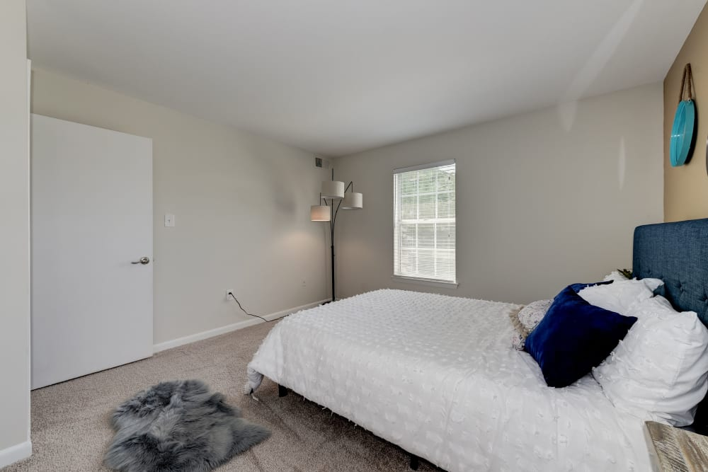 A large bedroom with windows at The Landings I & II Apartments in Alexandria, Virginia