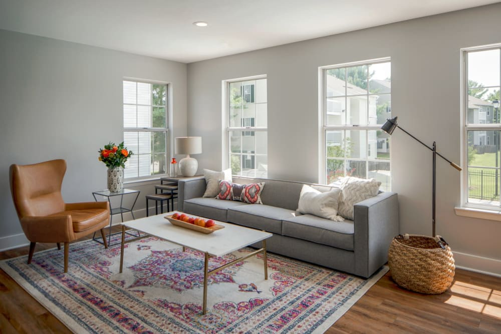 A spacious living room with large window at The Landings I & II Apartments in Alexandria, Virginia