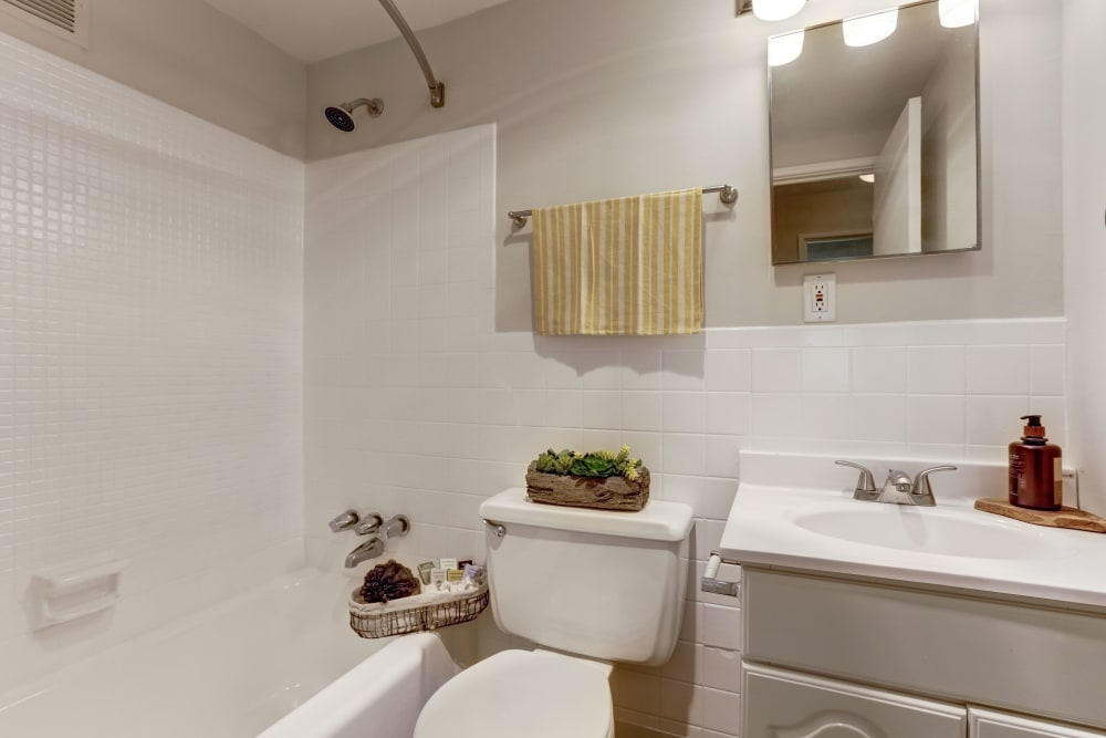 A large bathroom with an oval tub at The Landings I & II Apartments in Alexandria, Virginia