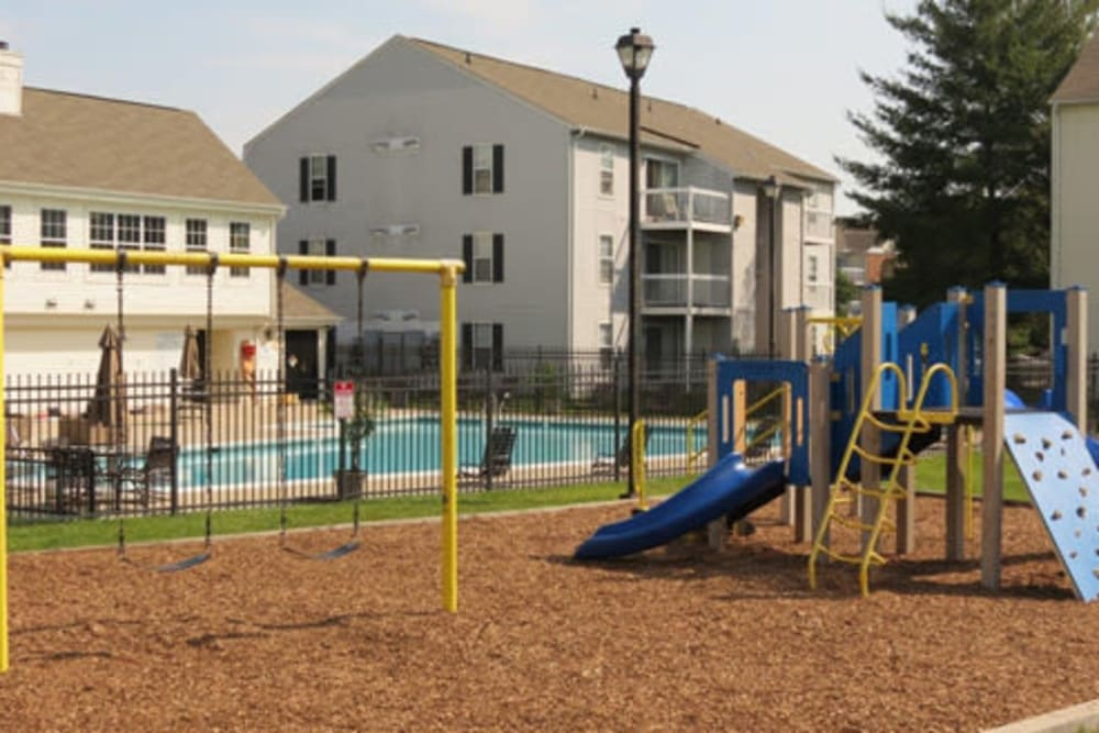 A children's playground with swings at The Landings I & II Apartments in Alexandria, Virginia