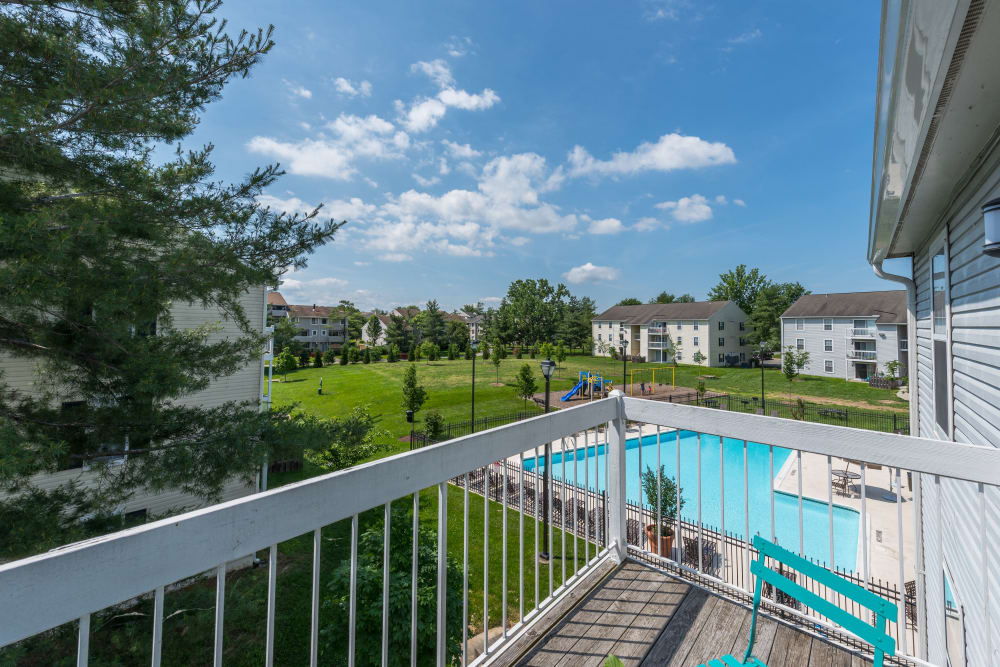 A balcony view of the swimming pool at The Landings I & II Apartments in Alexandria, Virginia