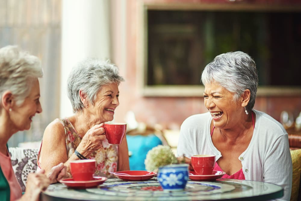 Three friends enjoying a nice cup of coffee talking about their day at Leisure Manor Senior Living in Sacramento, California