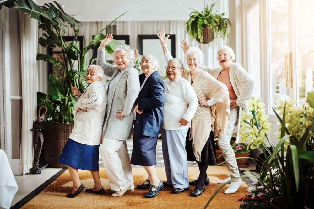 Group of residents posing for a fun photo at Leisure Manor Senior Living in Sacramento, California