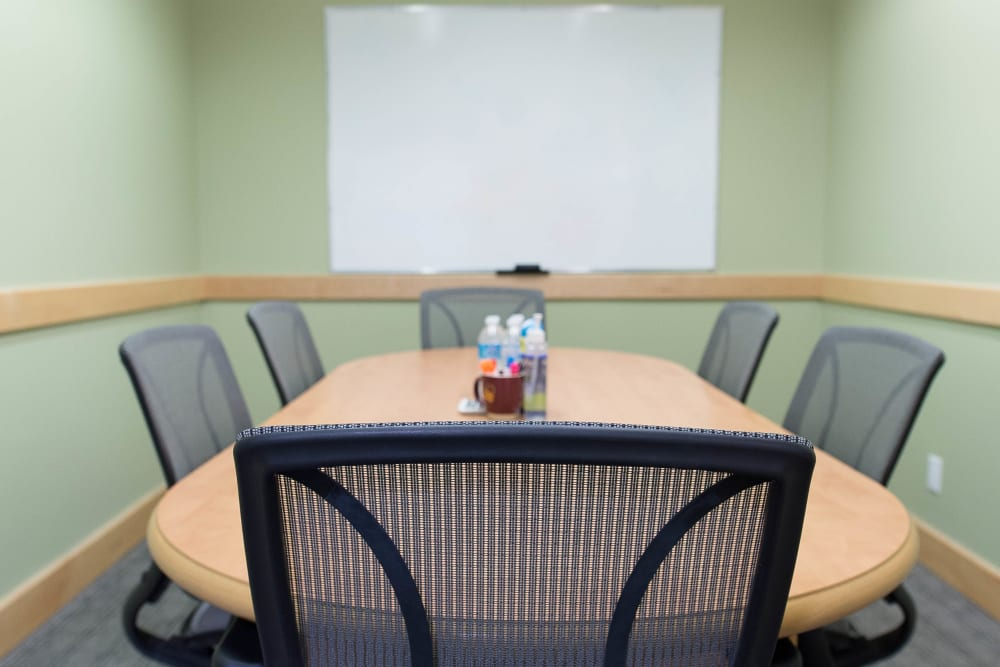 Meeting room with a whiteboard at Apple Self Storage - Toronto Downtown in Toronto, Ontario
