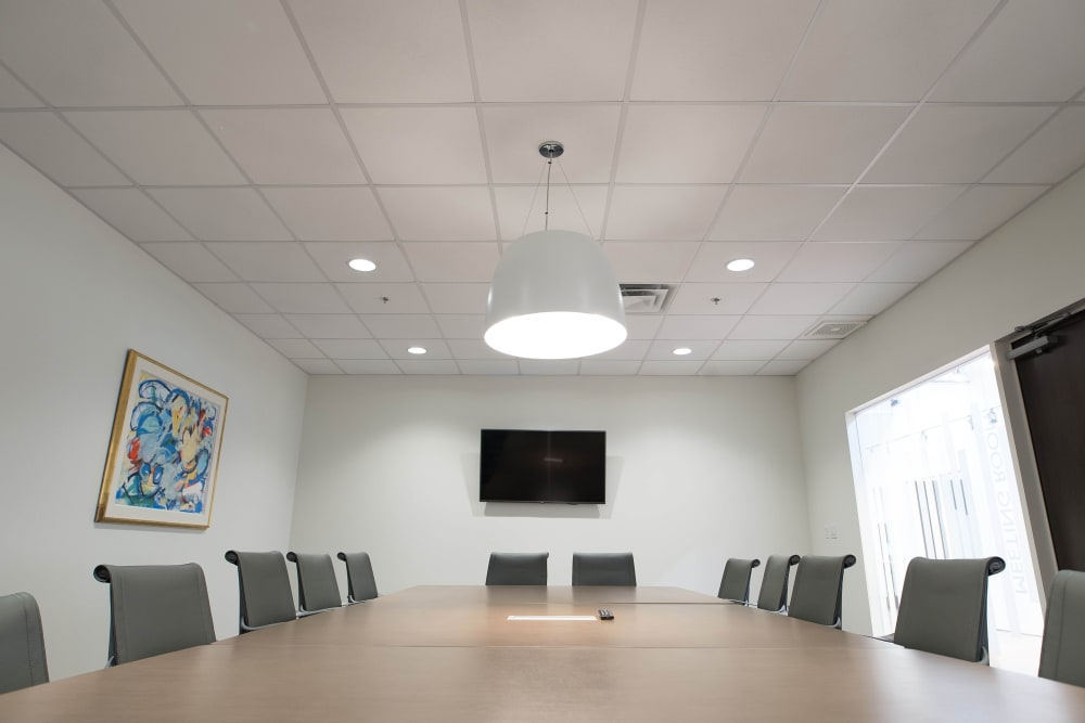 Meeting room with a TV at Apple Self Storage - Oakville in Oakville, Ontario