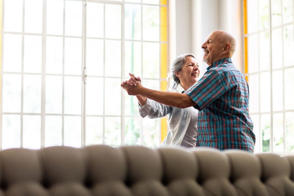 Couple dancing together at Park Place Senior Living in Sacramento, California