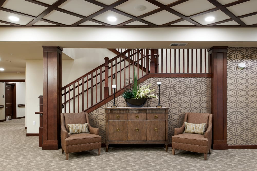 View of a large staircase and chairs at Willows Landing in Monticello, Minnesota