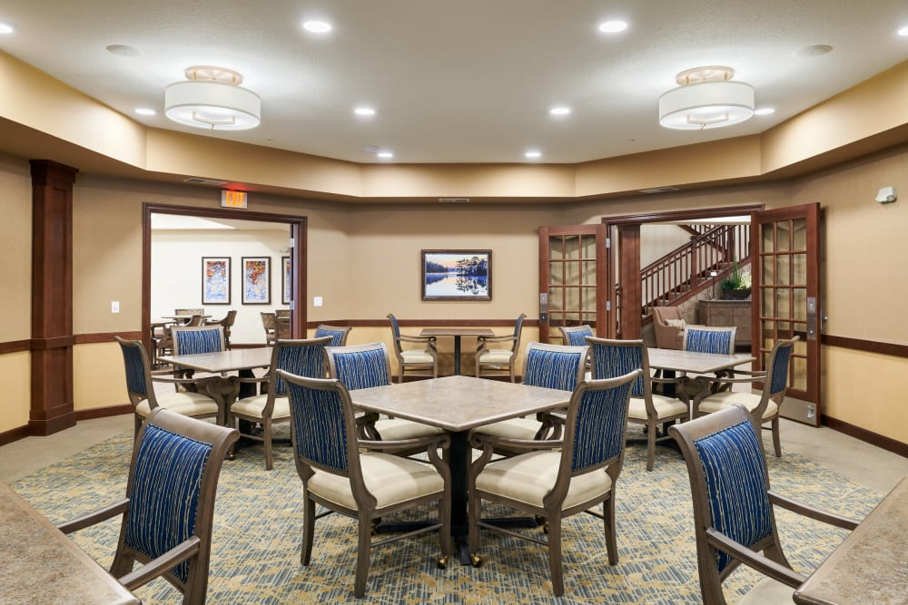 Room with tables and chairs at Willows Landing in Monticello, Minnesota