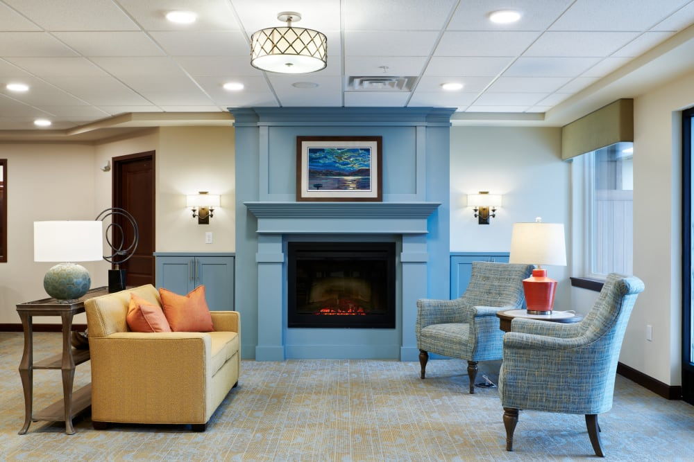 Lounge with fireplace at Willows Landing in Monticello, Minnesota